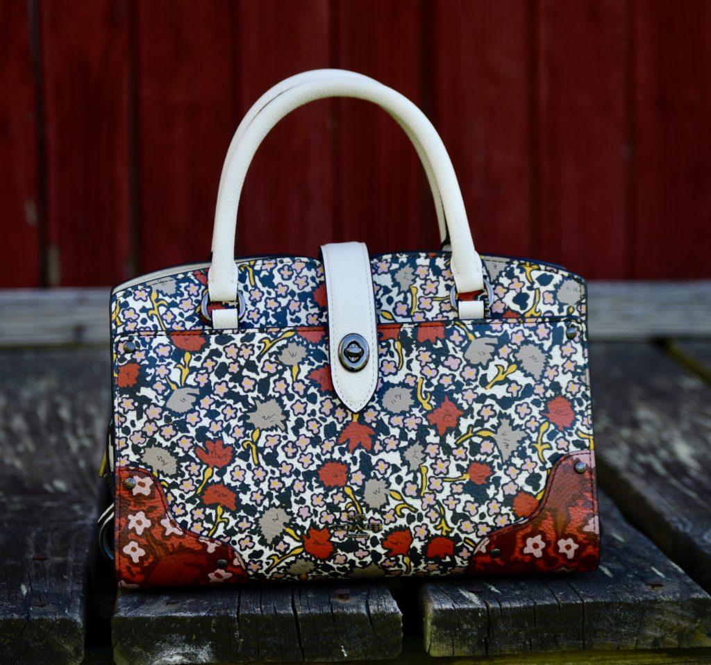 red and white print Coach handbag