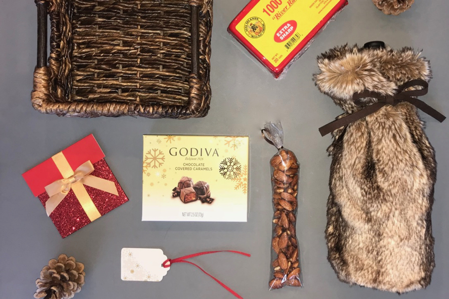 In a basket, put wine in a fur bag, chocolate, cheese, crackers or nuts, and a gift card to a restaurant.