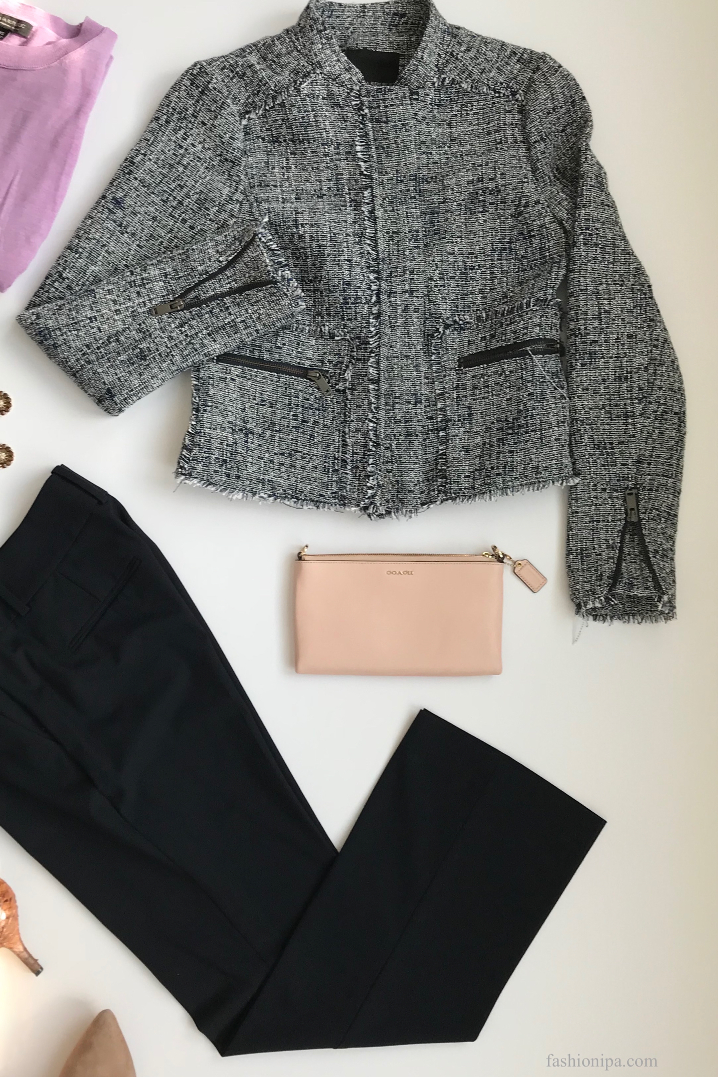 Flatlay of tweed jacket, lavender sweater, Coach clutch, navy pants, drop earrings and booties.