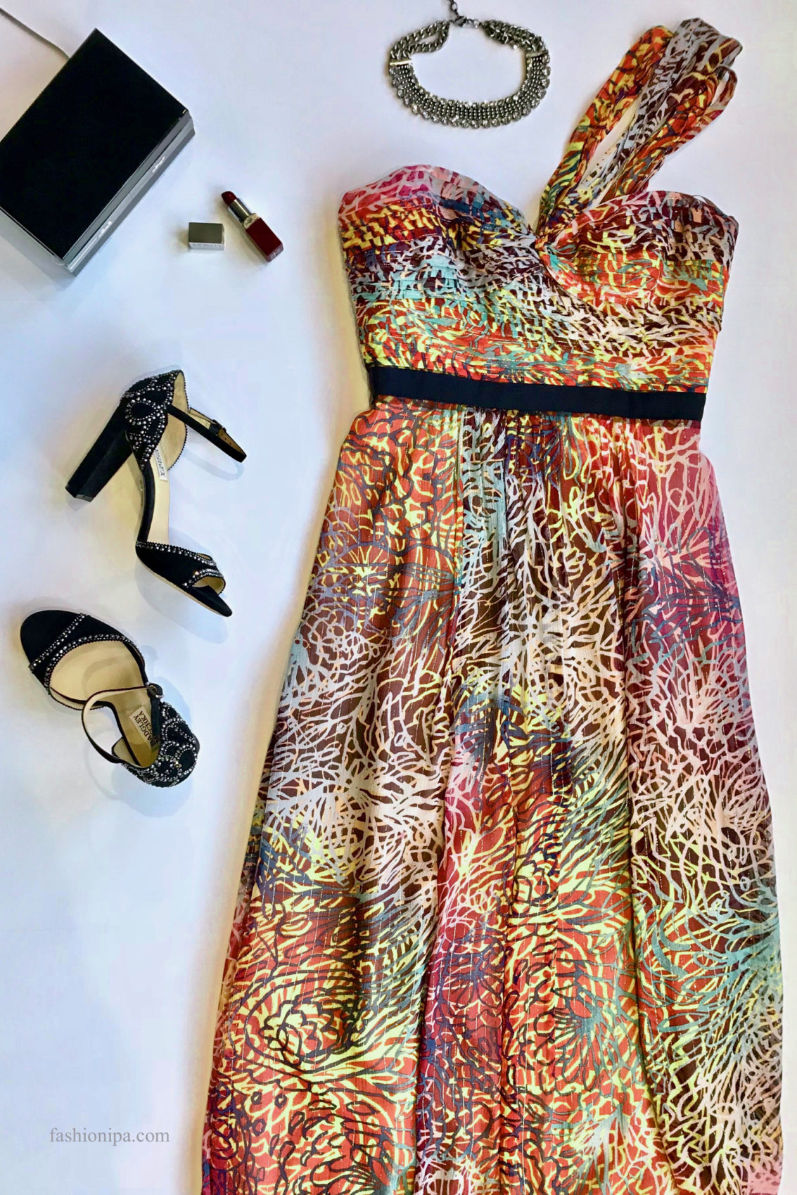 Printed gown, black box clutch, red lipstick, statement necklace, suede rhinestone shoes.