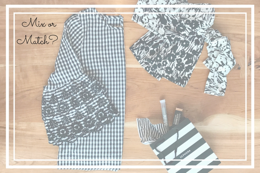 Flat lay of gingham check blouse, stripe bag and floral top.
