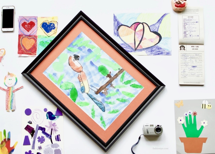 Flatlay of kids' art and writing