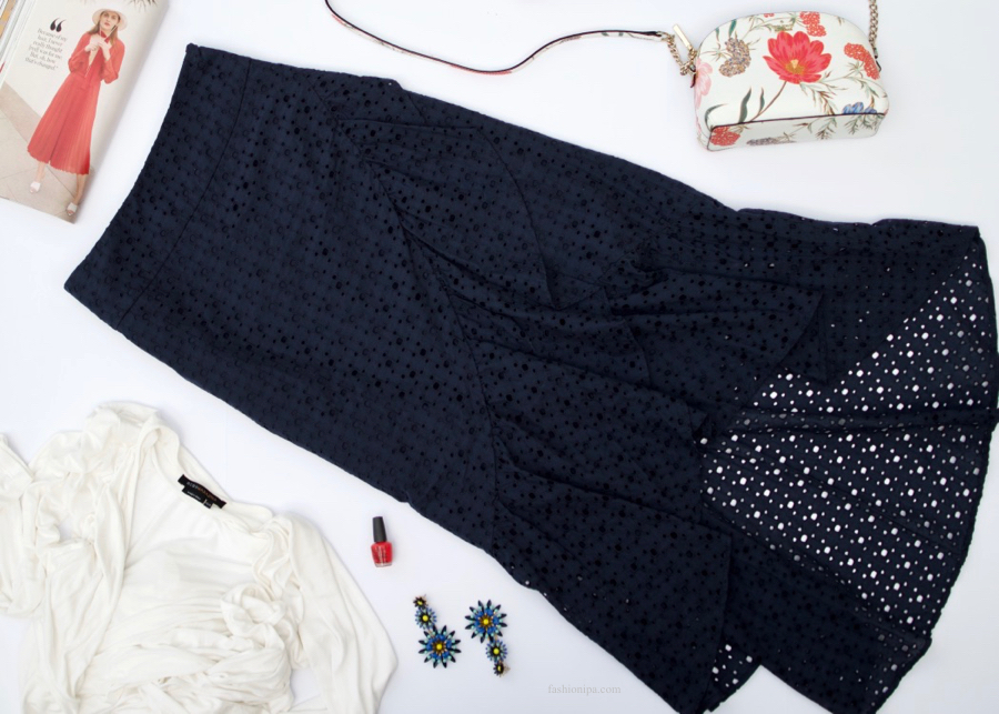 Navy Eyelet Skirt + White Wrap + Floral Handbag